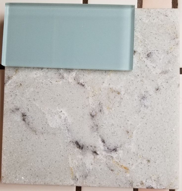 "Allen & Roth ""Titanium Swell"" quartz countertop and aqua glass artisan subway tile for kitchen counters and backsplash"