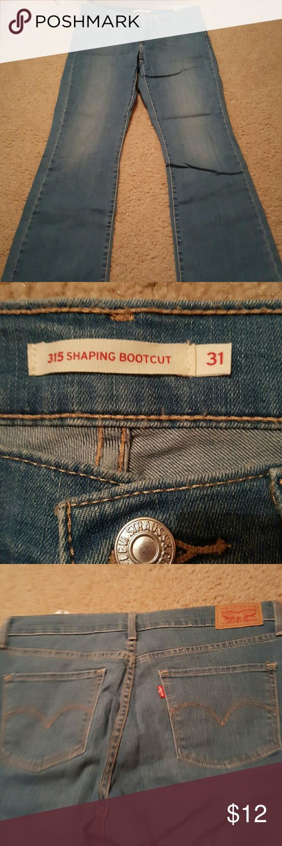 Shaping Levi Boot cut Jeans PRICED TO SELL!!!! only worn once!! Super slimming and lifts your booty!! Medium light wash (more on the light side.) Willing to bundle cheap with all my other stuff!! Levi's Jeans Boot Cut