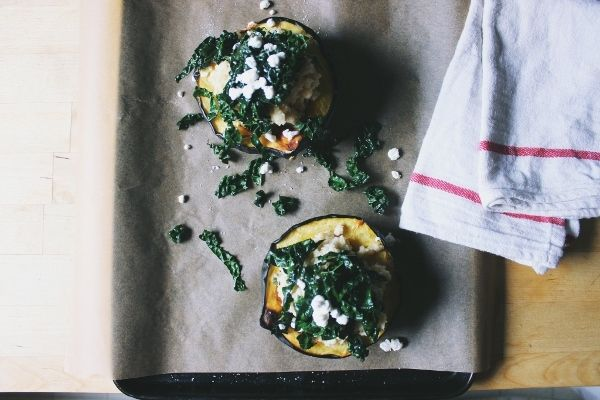 ... and Sage Stuffed Acorn Squash with Garlicky Greens & Goat Cheese