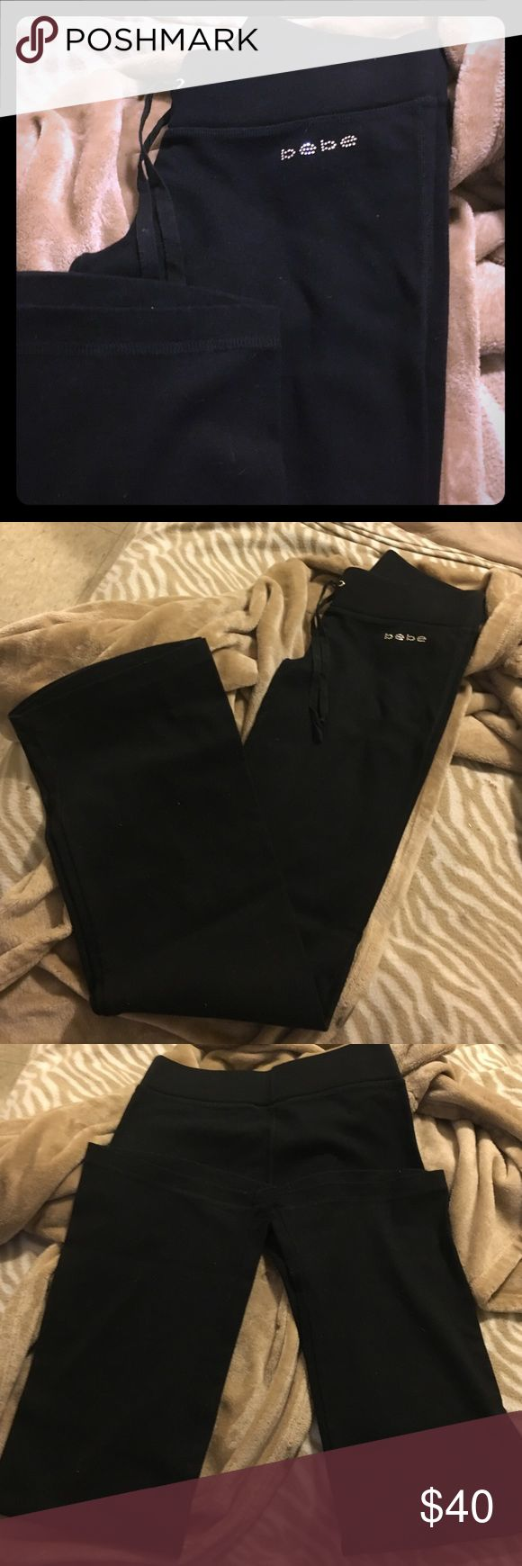 """🆕Bebe Rhinestone Embellished Black Joggers Brand New!  Bebe Designer Joggers.  Black &+ Rhinestone Embellishments. COMFORTABLE.  QUALITY.  Tie in the Front.  Size Small.  Questions Please Ask!  Laid Flat 32"""" Inseam. Laid Flat 14"""" Across the Waist.                                         📬Same Day Shipping! bebe Pants"""