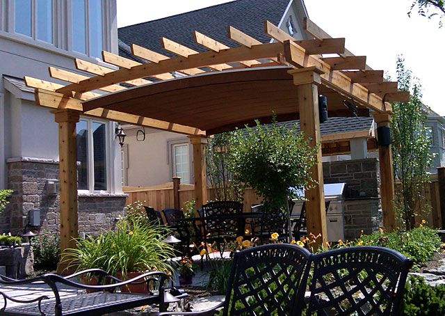 A Retractable Canopy System Custom Fitted Into Arched