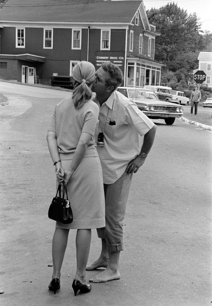Paul Newman steals a kiss from wife Joanne Woodward on the set of his directorial debut Rachel, Rachel (1968)