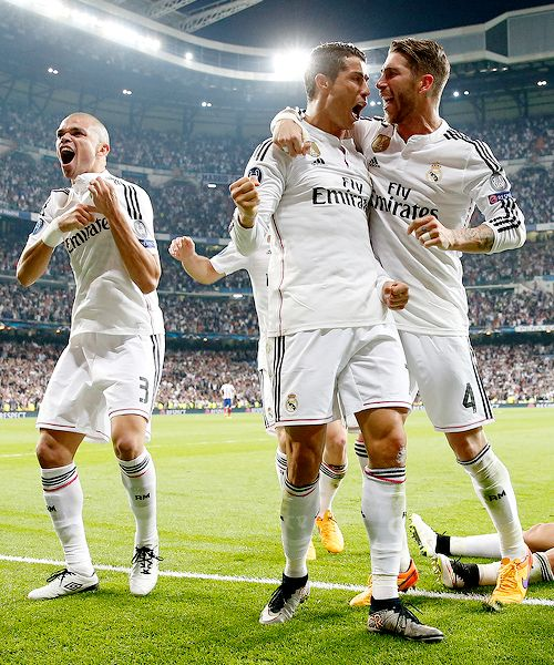 Ramos and Ronaldo having a moment while Pepe celebrates on his own