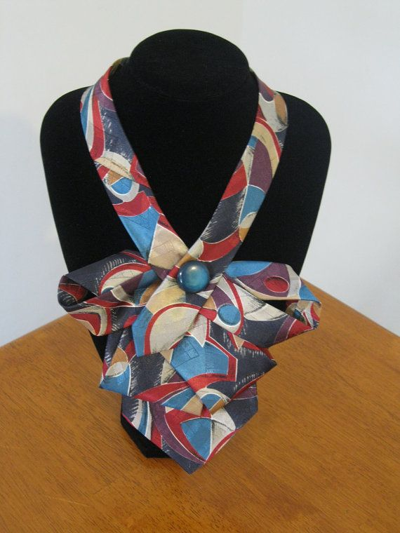Upcycled tie necklace featuring a fun abstract printed polyester tie in gorgeous shades of red, purple, turquoise, navy and cream.