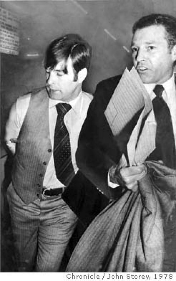 WHITE/B/27NOV78/MN/STOREY - Supervisor Dan White, taken into custody by Inspector Howard Bailey, SFPD, in the basement of the Hall of Justice. White was charged with the murder of Mayor George Moscone and Supervisor Harvey Milk. Photo by John Storey CAT Photo: JOHN STOREY