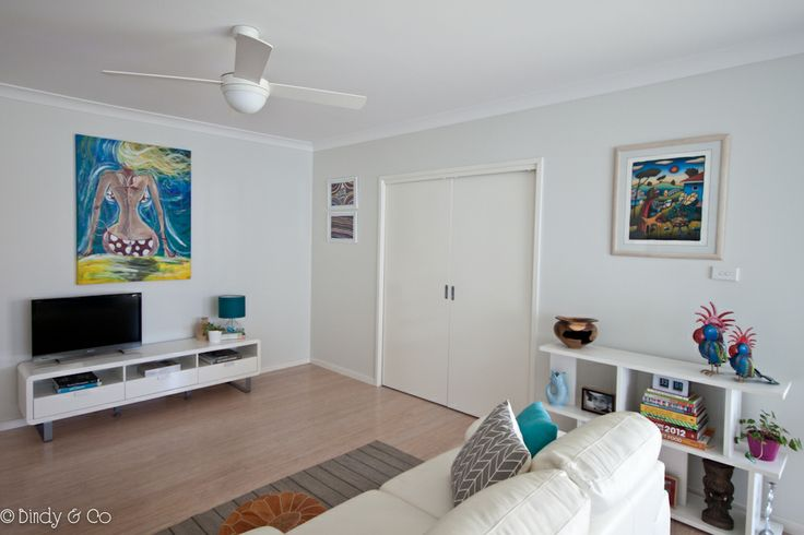 OPen plan living area from Bindy & Co. Large beach art painting above tv unit, cubic shelves from Freedom, Reg Mombassa print.