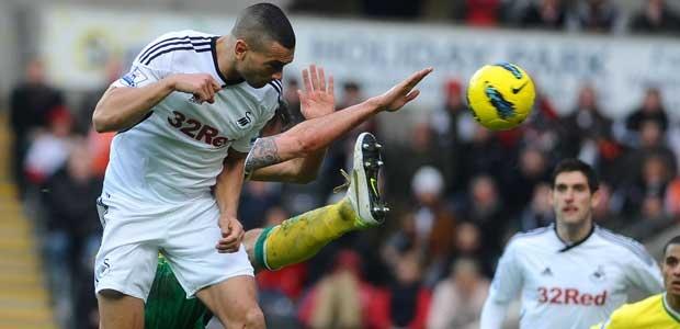 Swansea City discuss Steven Caulker deal with Tottenham Hotspur