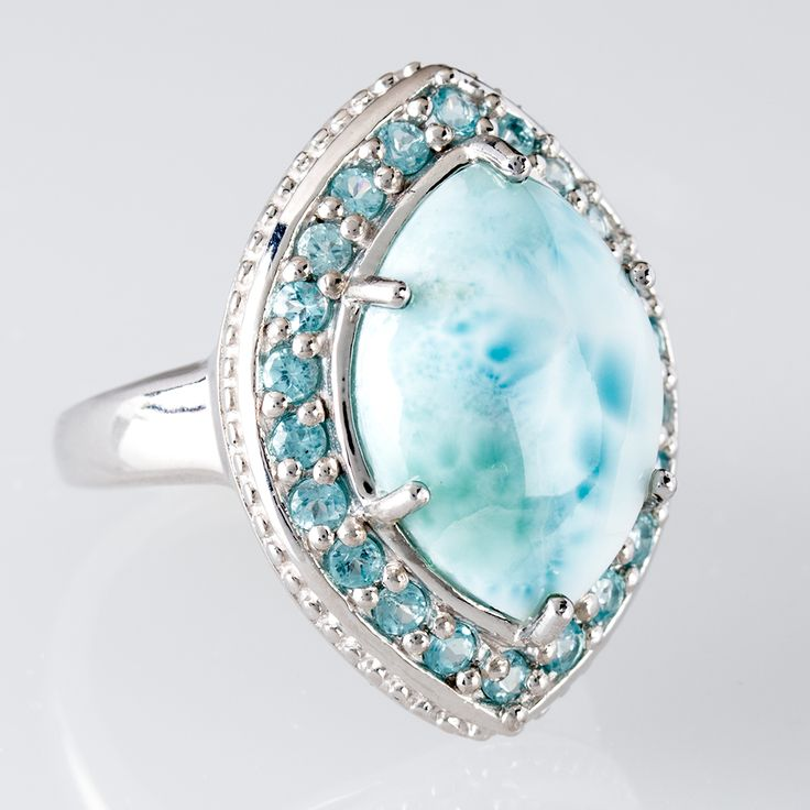 This ring combines the beauty of both the sea and sky. Larimar, this unique blue gem, was formed as a result of volcanic activity millions of years ago that created the Caribbean island of Hispaola.  It's truly island inspired! || Marquise Larimar With .94ctw Round Blue Apatite Sterling Silver Ring
