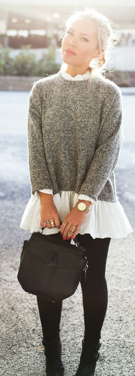 Shop this look on Lookastic:  https://lookastic.com/women/looks/crew-neck-sweater-long-sleeve-blouse-leggings-ankle-boots-satchel-bag-watch-ring/8507  — Grey Crew-neck Sweater  — White Pleated Long Sleeve Blouse  — Gold Watch  — Gold Ring  — Black Leather Satchel Bag  — Black Leggings  — Black Leather Ankle Boots