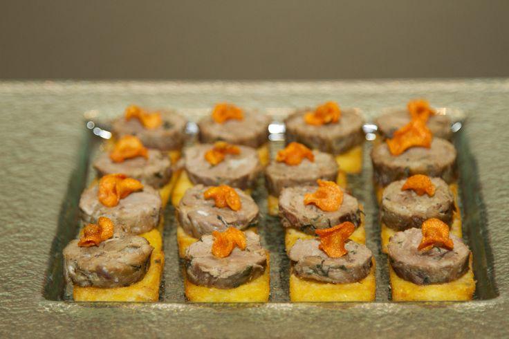 Roast lamb shoulder with rosemary polenta and carrot crisps