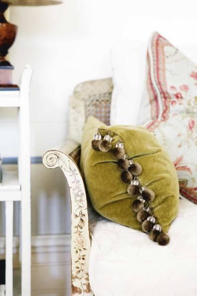 looks like a velvet cushion with fake fur pom-poms