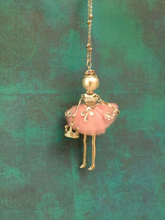Ellie's Belle Ariella! A ballerina doll necklace customized to match pink and silver dance recital costume, holding tiara charm.