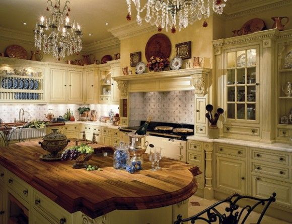 English Kitchen -butcher block island and double chandeliers!