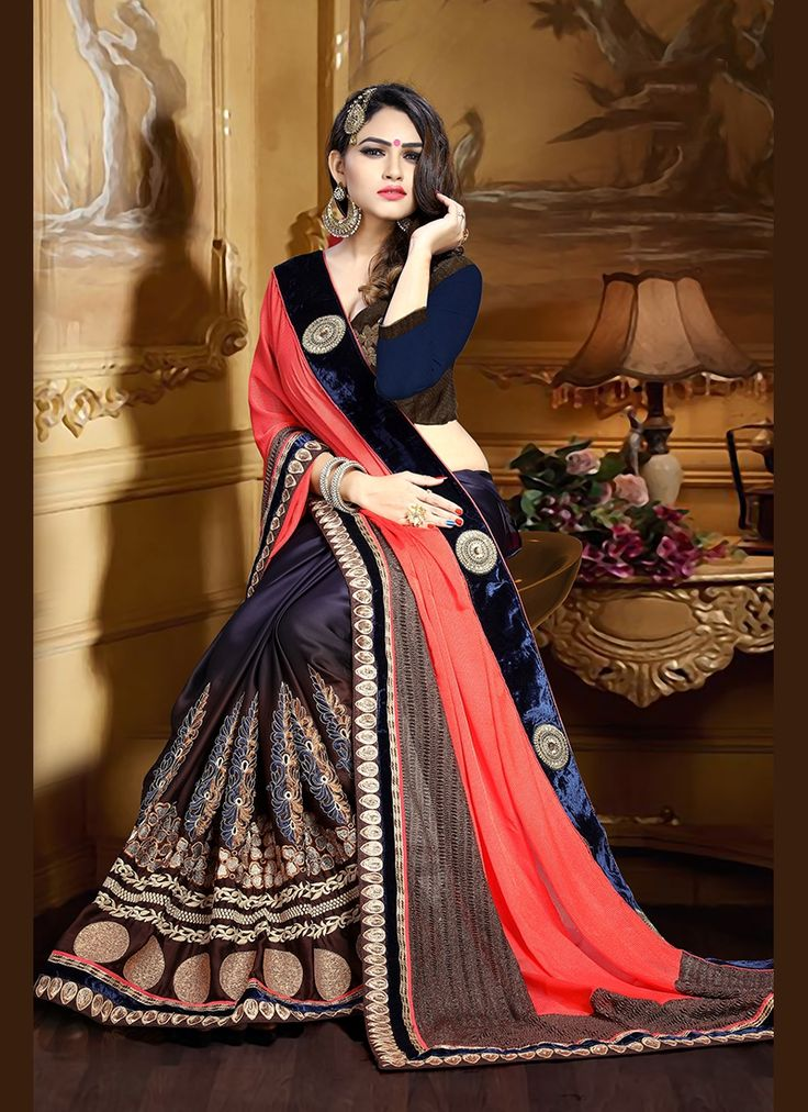 Get going with this #majestic and #wonderful piece and make your #dream #attire #look richer to your persona. Look sensationally awesome in this navy blue georgette and satin classic saree.