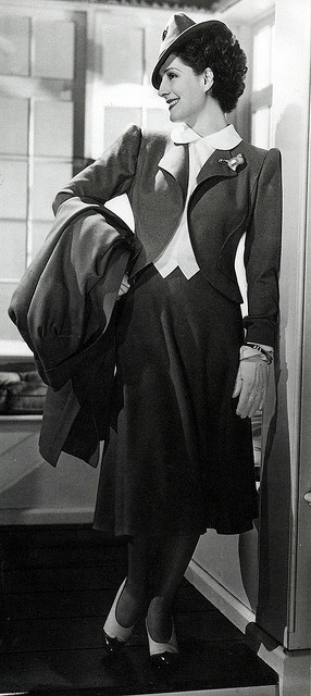 Norma Shearer in Adrian. Those lapels! The driving gloves! The captoe brogues!