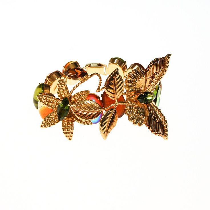 Zoe Coste Butterfly Bracelet with Green and Yellow Citrine RhinestonesWhat to say about this bracelet? It is a true statement piece and piece of art.A rare find French Couture find by Zoe CosteCabochons in beautiful dreamy green and golden yellow citirineGilt Butterflies in elegant gold toneFinished all the way aroundA wearable masterpiece  DETAILS 1960s EraSigned Zoe Coste, Made in FranceGilt Gold Leaves and ButterflyGlass CabochonsFold Over ClaspExcellent Vintage Condition …