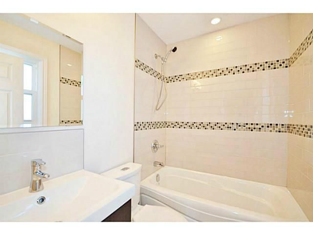 All around WHITE - tiles, tub, walls & sink!