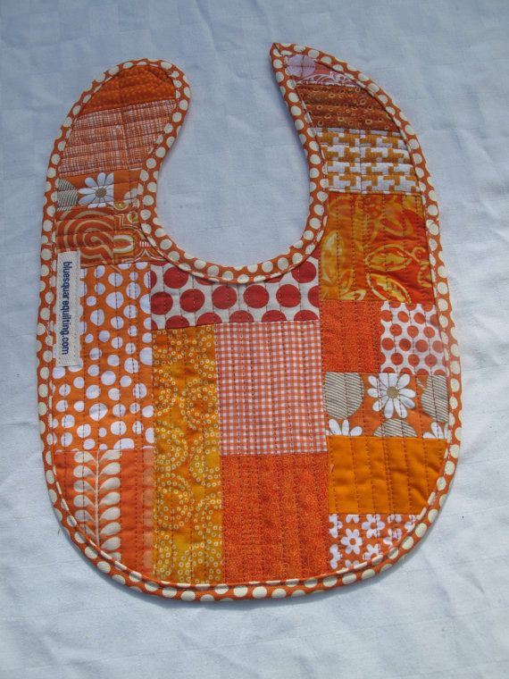Cute patchwork bib in orange and white  by bluesquarequilting