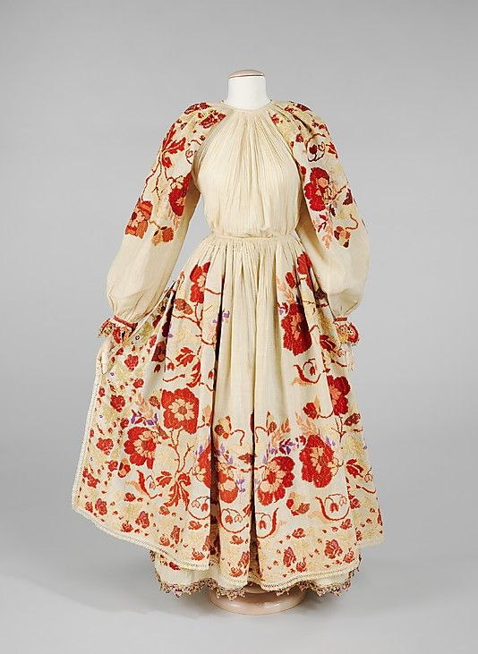 1900-1925 Bulgarian dress/costume. The graphic pattern on this heavily embroidered Bulgarian dress and apron was worked by hand, probably by a number of women of the community. The boldness of the design would have been particularly effective in a festival parade or ceremony.