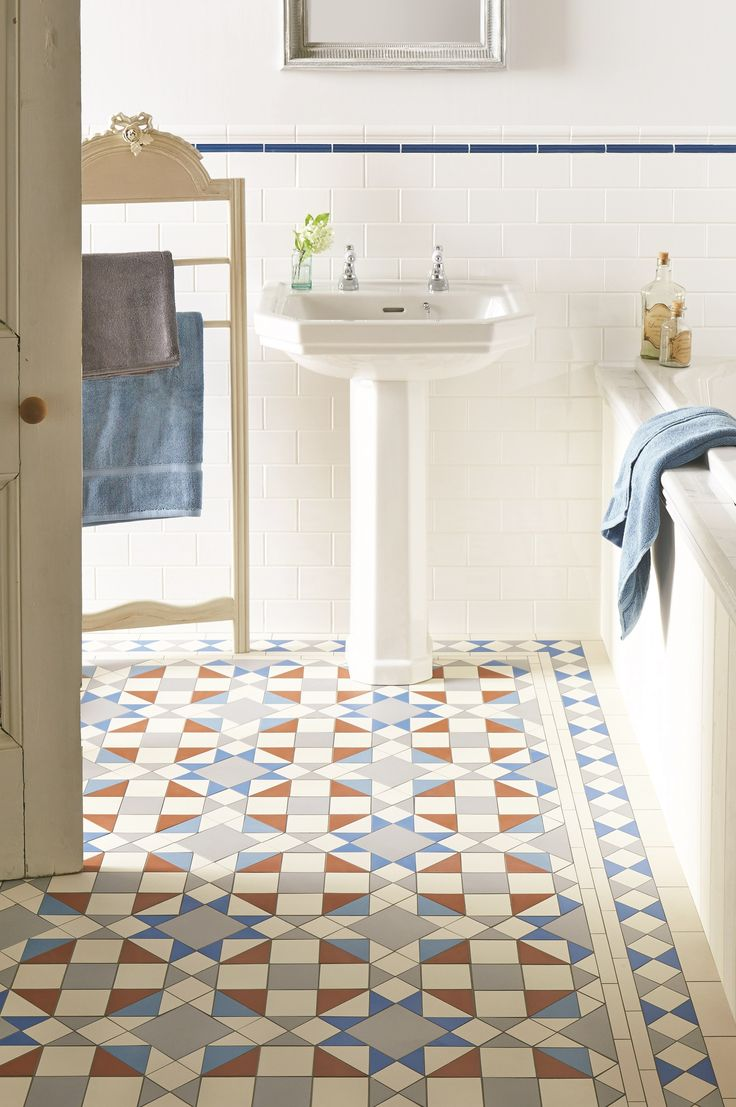 Eltham pattern with a new shade - bright Pugin Blue - makes a statement with all white bathroom sanitaryware. This pattern will make a statement in hallways, living rooms, bathrooms, kitchens - wherever it is used! New colours, patterns and shapes means our geometric Victorian style floor tiles look great in traditional and contemporary homes. originalstyle.com