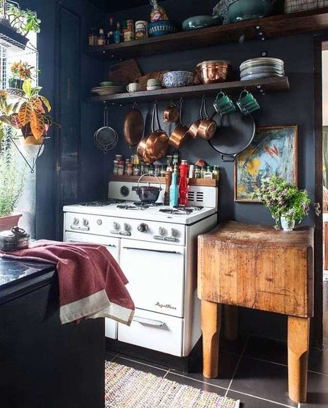 "Simple shelves and hanging up pans can really turn a small kitchen ""I've not got enough space"" into a fantastic cooking experience."