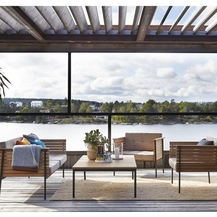 Piled with pillows and set around a jute rug, the HÄRINGE Lounge Sofa is perfect for creating an outdoor seating area. http://www.yliving.com/blog/introducing-skargaarden-modern-outdoor-furniture/ #YinTheWild