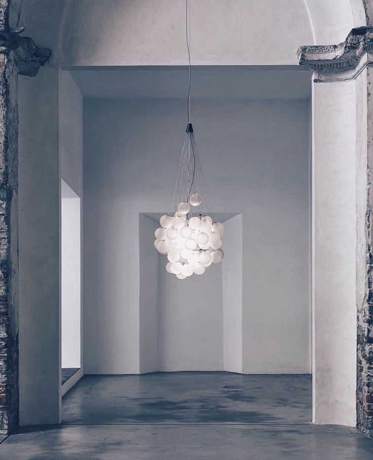 """Come in from the snow but bring the magic of the snowflakes with you with 'Stochastic'. Of his stunning piece for @Luceplan_lighting designer @DanielRybakken explains his inspiration  """"Traditional chandeliers are usually designed with rigid symmetrical repetition of a single piece such as a crystal prism. Stochastic also repeats the same object but in an apparently random way generating a special complexity. [...] With the light source concealed the light itself reflected & refracted becomes…"""