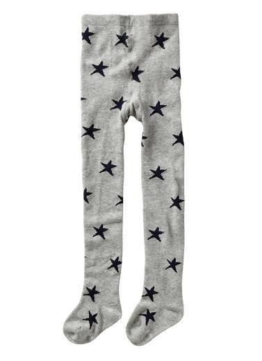 Girl's full length tight with stars. Cotton/nylon/elastane.