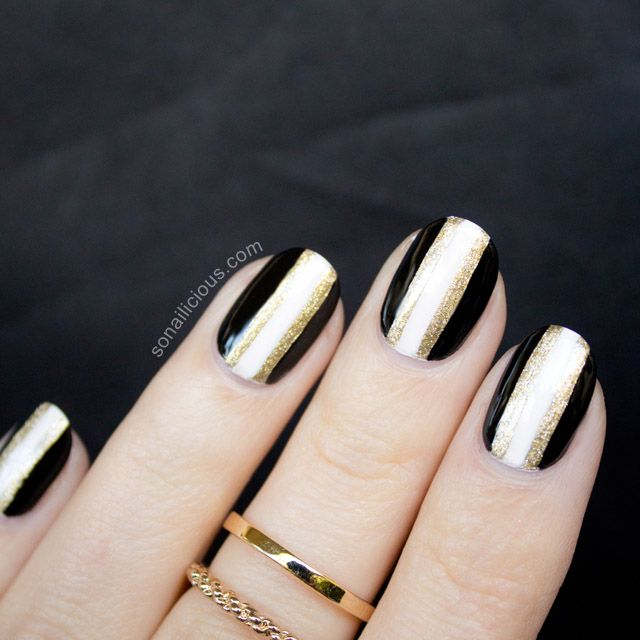 to celebrate the arrival of we did these elegant black and gold new years nails learn how to do this nail design at home