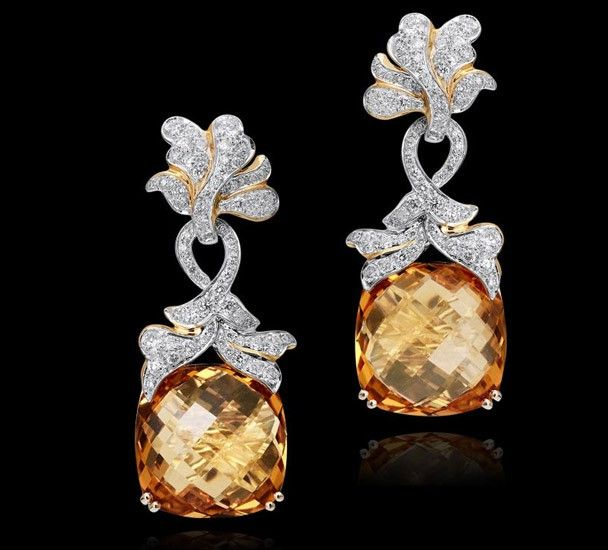 Citrine earring with diamonds set in 18k yellow gold.