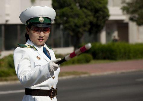 Traffic officer in Pyongyang - North Korea by Eric Lafforgue, via Flickr