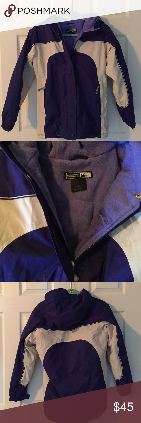 REI Fleece Lined Hooded Ski Coat purple and cream fleece lined hooded ski coat from outdoor adventure store REI. features velcro closure storm flap, oversized zipper pulls, elasticized fleece lined hood and interior zip electronics pocket. size large (14-16). excellent condition - worn on just one weekend snow trip. REI Jackets & Coats