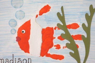 Hand print fish. I bet that paint brush tickled! Use two different colours to make this hand print craft/picture with your kids.
