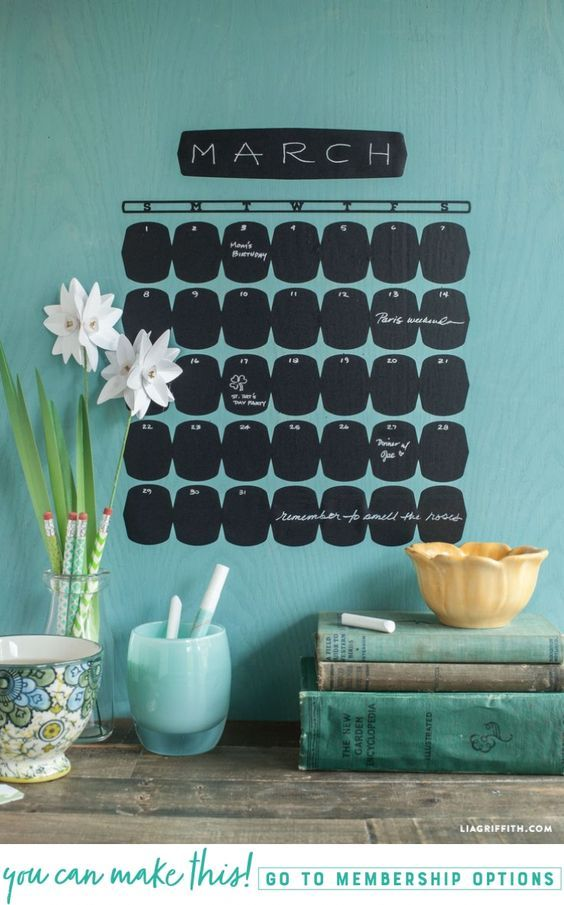 Make a fun and functional DIY chalkboard calendar for your home - Lia Griffith - www.liagriffith.com #diycalendar #chalkboard #diyhome #diyorganization #vinyl #diyidea #diyideas #madewithlia