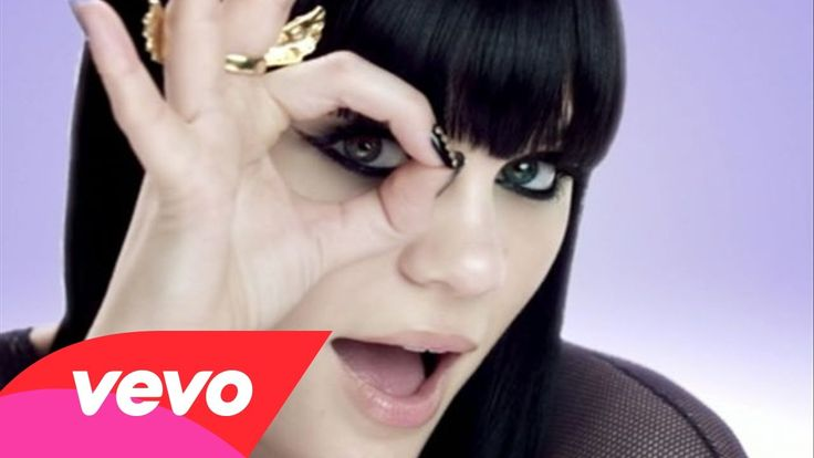 """An example of visuals being the opposite to the lyrics- while Jessie J sings about why """"It's not about the money"""", she dances under a tree made of money, wearing expensive clothing."""
