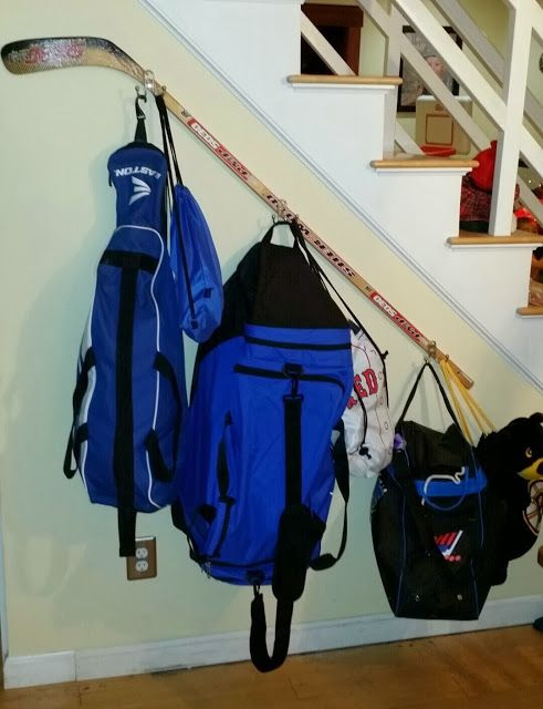 Hockey stick racks for hats and sports bags. Good use of the space.