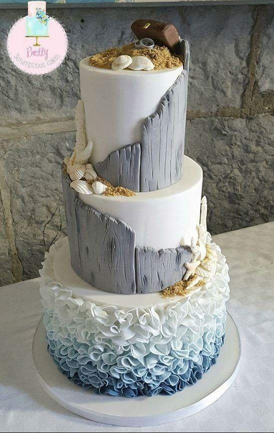 Beautiful ocean or beach themed cake. I like the slanted driftwood look. Wood fondant.