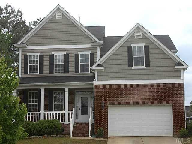 Delightful Low Maintenance Vinyl & Brick Siding!  Rocking Chair Front Porch is 21x5!  Two Car Garage offers lots of storage!