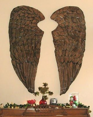 Faux wood wings made out of cardboard and paper mâché.