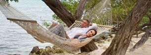 """Florida Keys Weddings - all inclusive resort, offers an """"elopement"""" package: Friday, Saturday and Sunday nights 2 to 6 people attending   Includes:      Ceremony location of your choice     Officiate to perform your personalized ceremony     One-hour of professional photography     A tropical bridal bouquet"""