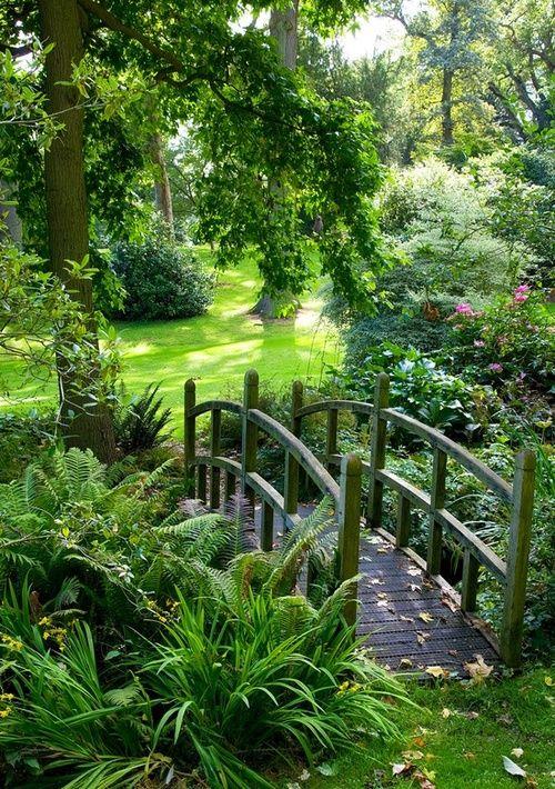 Beautiful little bridge in a green green garden