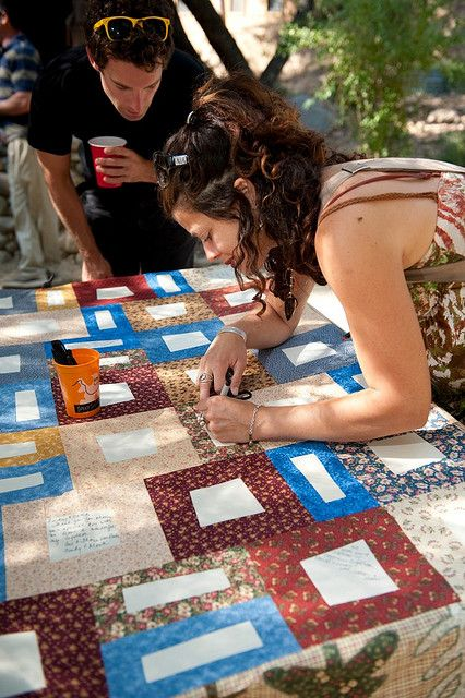 a quilt with blank squares to sign as a wedding guestbook? nice.