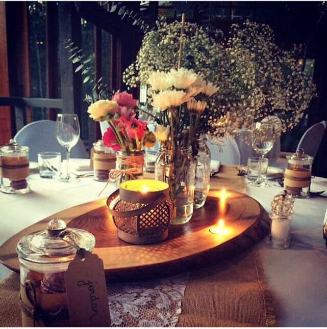 Our personally created rustic table centre pieces