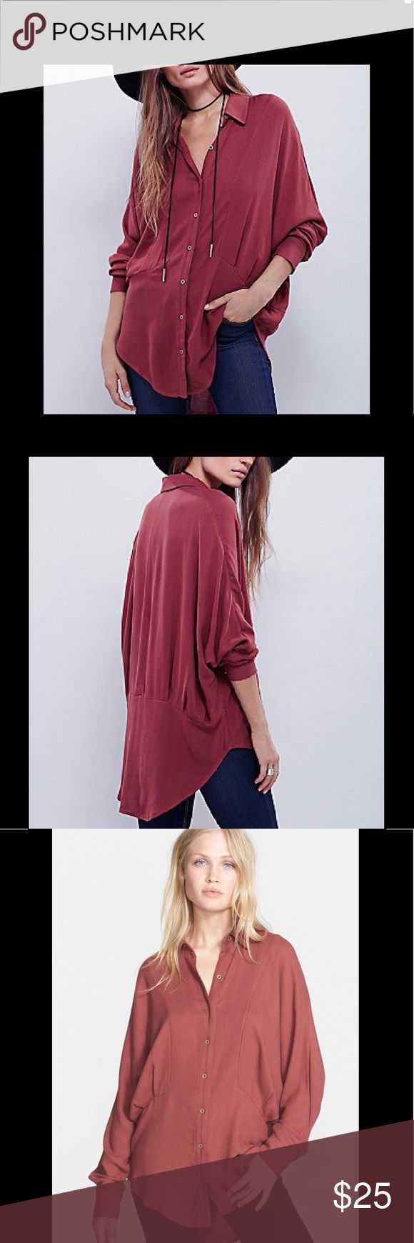 """Free People True Affection Herringbone Shirt Free People 'True Affection' Herringbone Button Down Shirt, size medium, color is earth red. Slouchy dolman sleeves & a draped shirttail hem accentuate the stylishly oversized fit of a paneled button down shirt textured in a subtle Herringbone motif. 30"""" length, spread collar, 2 button barrel cuffs, 100% rayon. First 3 photos are stock photos, in good used condition but it does have some pilling from wear that you can see in the last few pictures…"""
