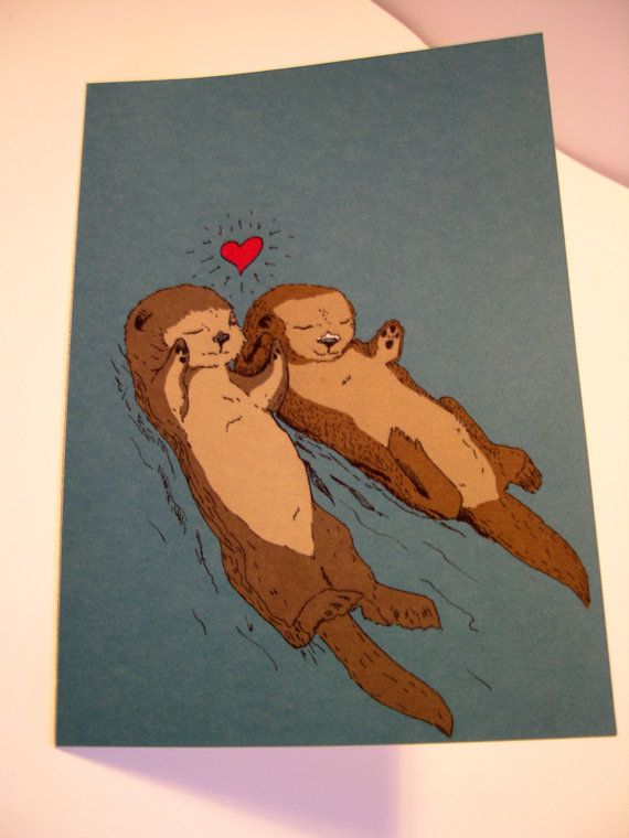 Otterly in Love. Otters hold hands while sleeping so they don't drift away from each other.