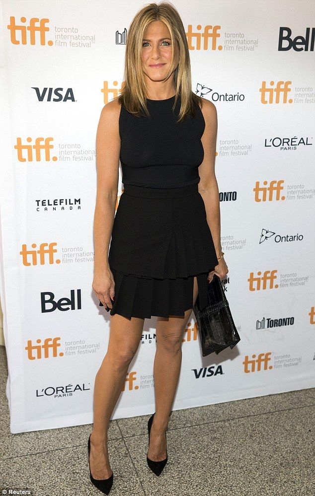 Looking happy: Jennifer Aniston showed her beaming smile and toned figure in a slimming little black dress while leaving a TIFF event in Toronto, Canada on Monday