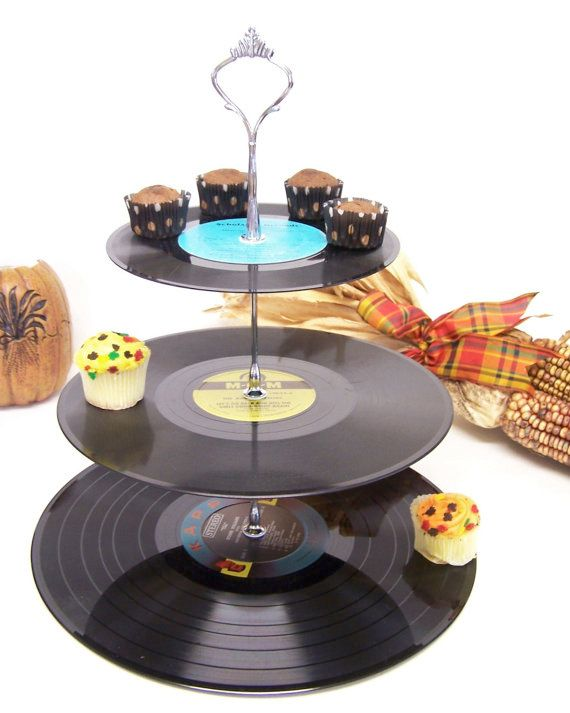 Cute idea, but make sure to use sturdy records...and it works best with mini cupcakes too.