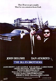 The Blues Brothers 1980 starring John Belushi and Dan Aykroyd. It features James Brown, Cab Calloway, Aretha Franklin, Ray Charles, and John Lee Hooker.