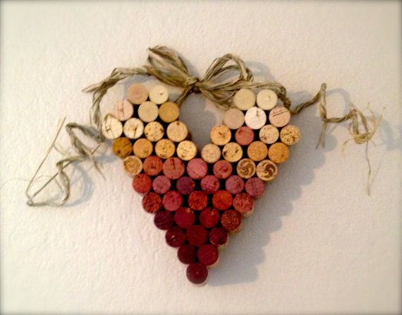 This is a lovely heart made from wine corks. The gradient of purples is a result of being in the bottles. The bow is made of raffia. The heart hangs from the wall from the bow. The heart measures about a foot. Lightweight and adorable. Makes a great gift for wine lovers