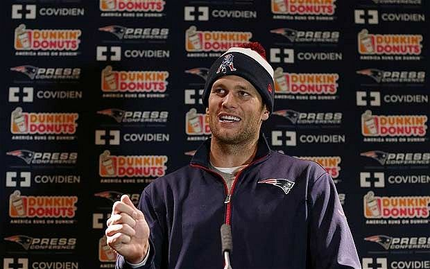 Icon: even when he has just stepped off a red-eye flight from Boston, and strides into a ballroom at Grosvenor House still wearing a bobble hat, Tom Brady exudes an inescapable poise and presence
